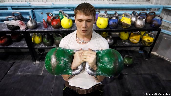 A man lifts weights at a sports complex at the Aksu Ferroalloys Plant in the town of Aksu, north-eastern Kazakhstan (Reuters/S. Zhumatov)