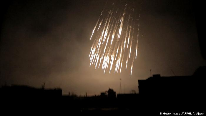 Apparent glowing white phosphorus raining from the sky over eastern Ghouta (Getty Images/AFP/H. Al-Ajweh)
