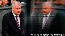 German Interior Minister Horst Seehofer addresses the lower house of parliament, the Bundestag