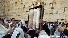 JERUSALEM, ISRAEL - APRIL 8: (ISRAEL OUT) Religious Jews descended from the biblical priestly caste cover themselves with prayer shawls as they perform the priestly blessing during Passover festivities at the Western Wall, Judaism's holiest site, April 8, 2004 in Jerusalem's Old City, Israel. Following Jewish tradition, observant Jews make a pilgrimage to Jerusalem three times per year for the ceremony. (Photo by Uriel Sinai/Getty Images)