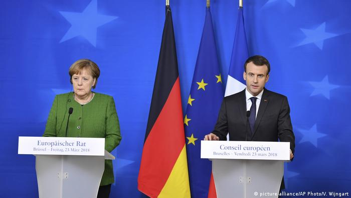 French President Emmanuel Macron, right, and German Chancellor Angela Merkel participate in a media conference at the conclusion of an EU summit in Brussels on Friday,