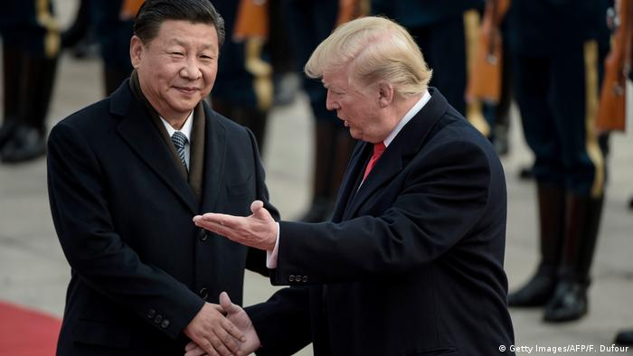 China's President Xi Jinping (L) and US President Donald Trump at a ceremony at the Great Hall of the People in Beijing in November