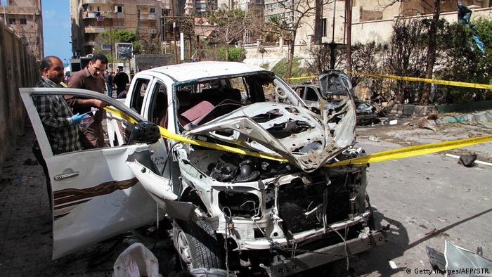 A destroyed vehicle at the site of a bomb attack in the Egyptian city of Alexandria