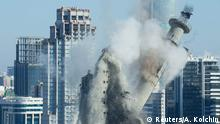 The unfinished and abandoned TV tower collapses during a controlled demolition in Yekaterinburg
