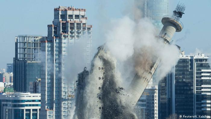 The unfinished and abandoned TV tower collapses during a controlled demolition in Yekaterinburg (Reuters/A. Kolchin)