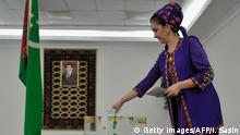 25.03.2018 *** A woman casts her ballot during the parliamentary elections in Ahgabat on March 25, 2018. Voting was underway in Turkmenistan in a parliamentary election which could indicate a path towards hereditary succession in the authoritarian, gas-rich former Soviet state. A total of 284 candidates are competing for 125 seats in parliament, but only one stands out from the crowd -- Serdar Berdymukhamedov, son of all-powerful President Gurbanguly Berdymukhamedov. / AFP PHOTO / Igor SASIN (Photo credit should read IGOR SASIN/AFP/Getty Images)