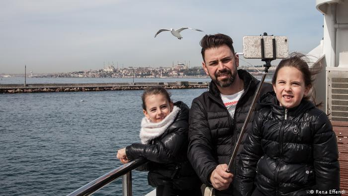 A family takes a selfie on one of the Bosporus ferries (Rena Effendi)
