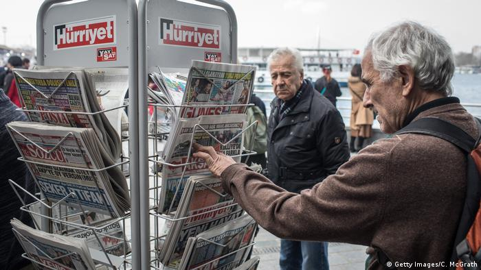 A man looks at Turkish newspapers on a stand (Getty Images/C. McGrath)