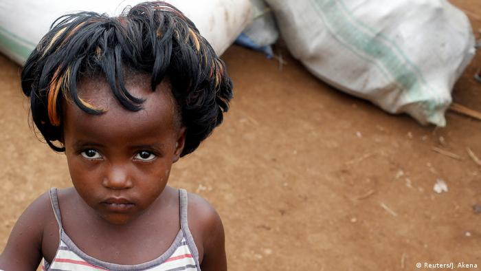 A little Congolese girl looks forlorn at a refugee camp in neighboring Uganda.
