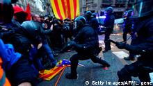 Protesters clash with riot police blocking the road leading to the central government offices during a demonstration in Barcelona on March 25, 2018 after Catalonia's former president was arrested by German police. German police arrested Catalonia's deposed leader Carles Puigdemont on March 25, 2018, five months after he went into self-imposed exile in Belgium over his failed bid to break the region away from Spain. / AFP PHOTO / LLUIS GENE (Photo credit should read LLUIS GENE/AFP/Getty Images)