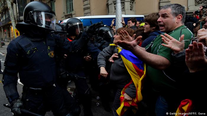 Protesters in Barcelona clash with police over the arrest of Carles Puigdemont