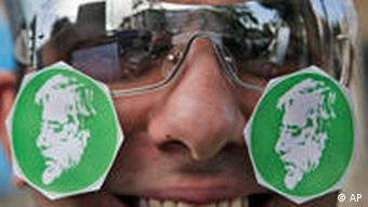 Man with stickers showing Mousavi on his cheeks