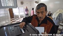 26.03.2018+++ An elderly Egyptian casts his vote on the first day of the 2018 presidential elections at a polling station in al-Haram neighbourhood in the capital Cairo's southwestern Giza district on March 26, 2018. Egyptians head to the polls in a three-day vote to choose between incumbent Abdel Fattah al-Sisi and little-known candidate Moussa Mostafa Moussa, who has struggled to make the case he is not Sisi's minion. / AFP PHOTO / MOHAMED EL-SHAHED (Photo credit should read MOHAMED EL-SHAHED/AFP/Getty Images)
