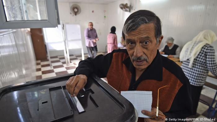Man looks up while casting his ballot in Egypt (Getty Images/AFP/M. El-Shahed)