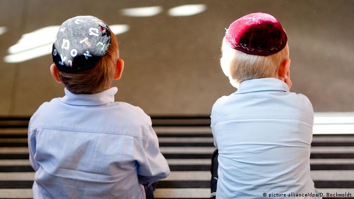 two boys wearing yarmulkes