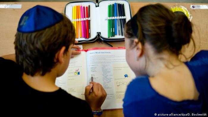 Jewish boy and a girl at school