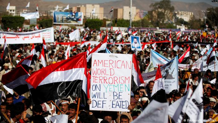 A protester in Sanaa holds up an English-language placard saying: American world terrorism on Yemen will be defeated (Reuters/K. Abdullah)
