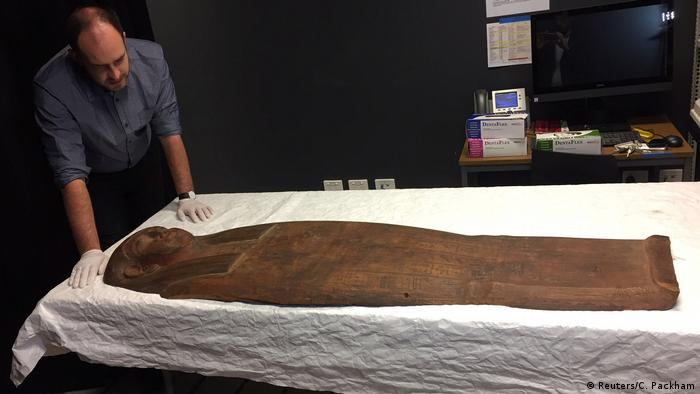 A researcher observing a 2,500-year old Egyptian coffin