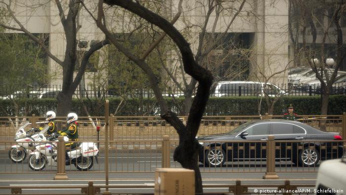 Security forces escort a limousine through Beijing, sparking speculation that the ruler of North Korea, or a senior official, was visiting China