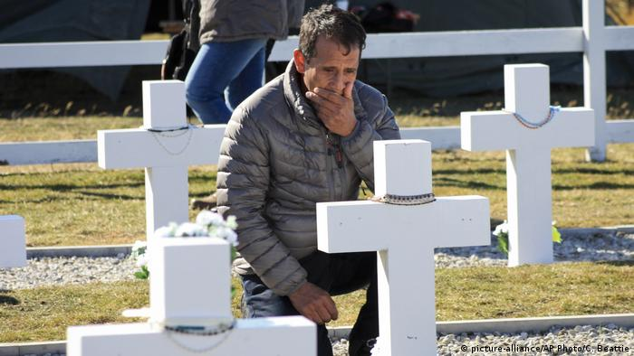 A relative of an Argentine soldier killed during the 1982 Falklands War mourns at the grave of his loved one.