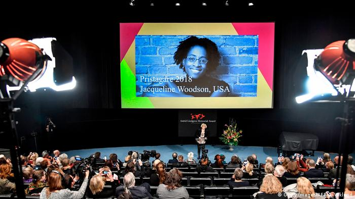 Woodson's face on a big screen as the award is announced (Getty Images/AFP/A. Wiklund)