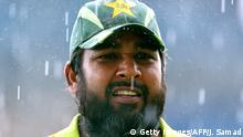 Kingston, JAMAICA: Pakistani cricketer Inzamam-ul-Haq, who is playing his last one-day international, leads his team out of the field under a downpour during the Group D match of the ICC World Cup Cricket 2007 against Zimbabwe at the Sabina Park Cricket Ground in Kingston 21 March 2007. Zimababwe lost three wickets and scored 30 runs before the match was halted due to the rain as they chase Pakistan's 349. AFP PHOTO/Jewel SAMAD (Photo credit should read JEWEL SAMAD/AFP/Getty Images)