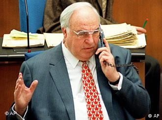 German Chancellor Helmut Kohl receives a phone call in Bonn Parliament Thursday, March 5, 1998. Kohl rejects suggestions that he call a vote of confidence to prove he can still run Germany after two stunning opposition triumphs. Within five working days, the up-and-coming Social Democrats win a huge state election, giving momentum to Kohl's challenger Gerhard Schroeder, and engineer Kohl's biggest legislative defeat in 16 years in power. (AP PHOTO/Hermann J. Knippertz)