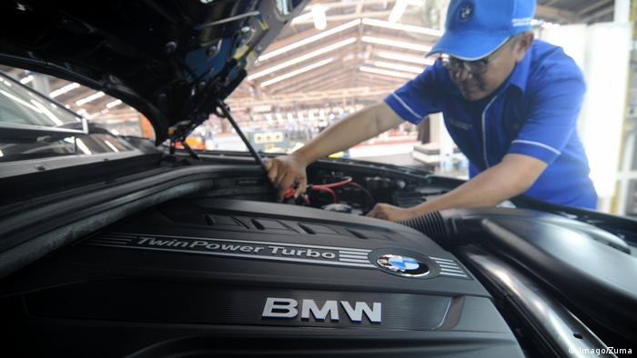 Workers assemble the third generation of BMW X5 Advance Diesel automobile on the production line.