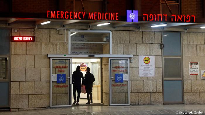 People are seen in front of the entrance to the emergency room at the Hadassah Ein Kerem hospital in Jerusalem