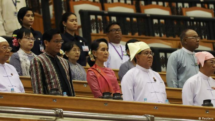 Myanmar's State Counsellor Aung San Suu Kyi (C) attends a parliament session