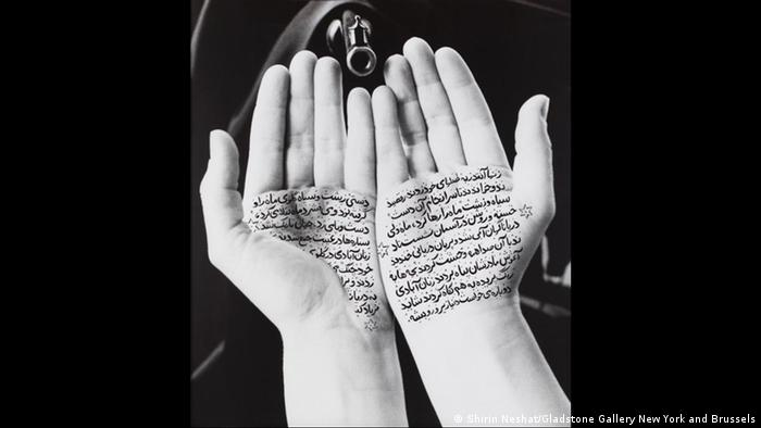 A chador, a rifle, hands and a poem — a typical shot from Neshat's series Women of Allah from 1996 (Shirin Neshat/Gladstone Gallery New York and Brussels)