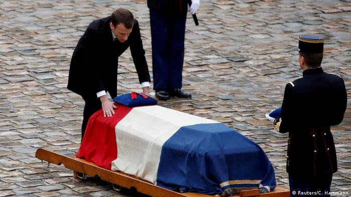 Macron touching coffin of Arnaud Beltrame (Reuters/C. Hartmann)
