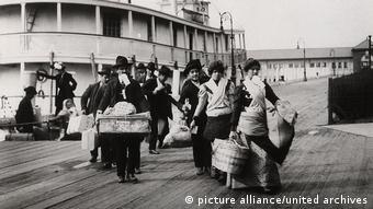 Emigrants disembarking at Ellis Island around 1900