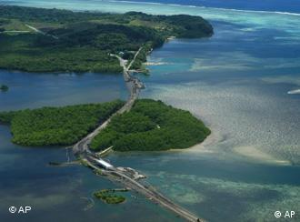 This July 2005 photo provided by the Army Corps of Engineers shows an aerial view of two causeways built on the northeast coast of the island of Babeldoab, the largest of Palau's more than 300 islands. The U.S. has finished building a 53-mile road on the largest of Palau's islands, fulfilling a promise Washington made when the Pacific nation gained independence 13 years ago. (AP Photo/Courtesy of the Army Corps of Engineers)