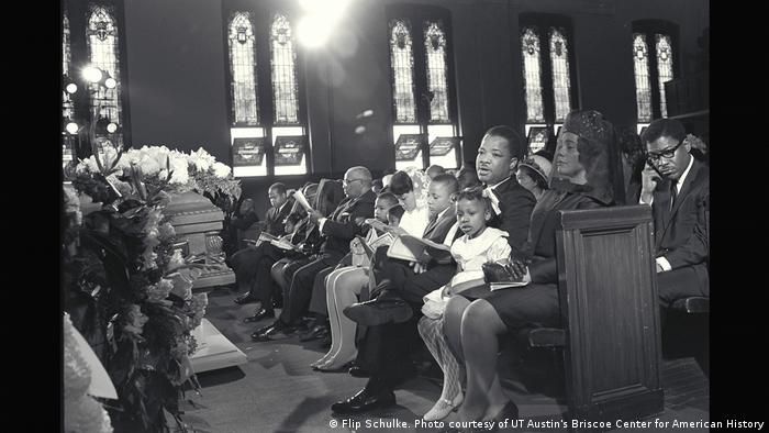Coretta Scott King, wife of Martin Luther King, Jr., and family sit in a pew during the first of two funeral services held on April 9, 1968, in Atlanta, Georgia