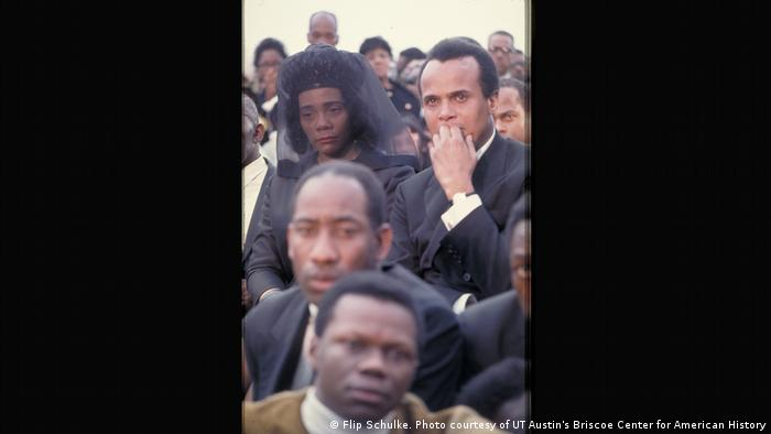 Beside Coretta Scott King weeps Harry Belafonte, the American singer, actor and social activist