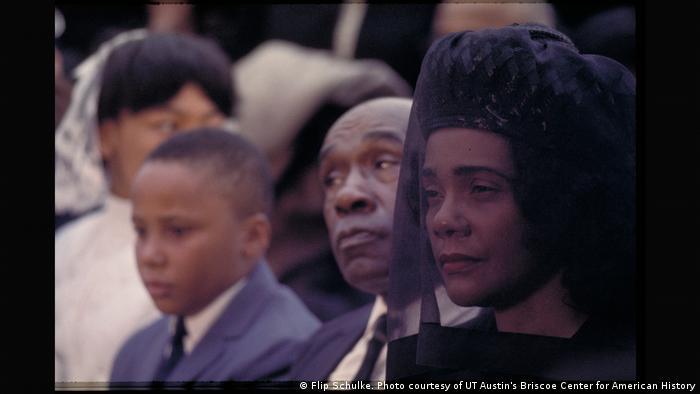 Coretta Scott King gazes through a black veil at her husband's funeral