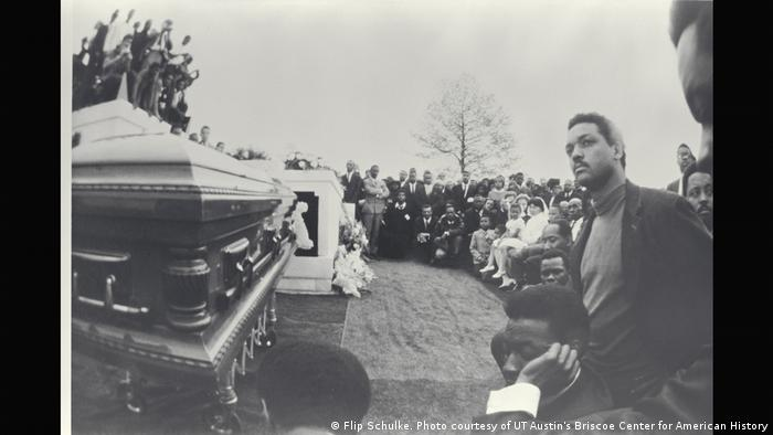 A bewildered Reverend Jesse Jackson, the American civil rights activist and politician, beside King's graveside