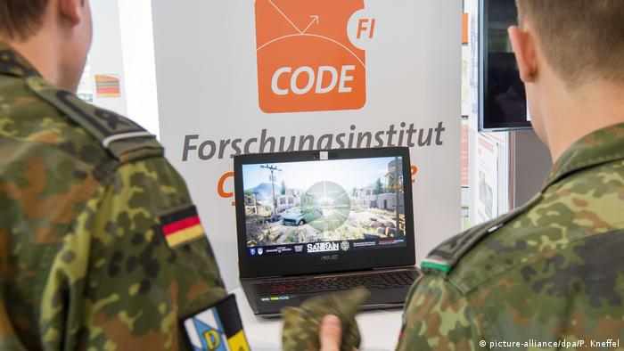 Two soldiers using digital technology at the Bundeswehr University in Munich, Germany