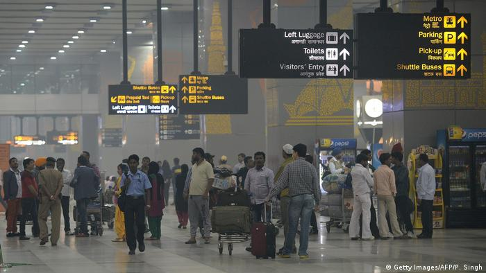 Passengers seen in the arrival hall at Terminal 3 of Indira Gandhi International airport in New Delhi