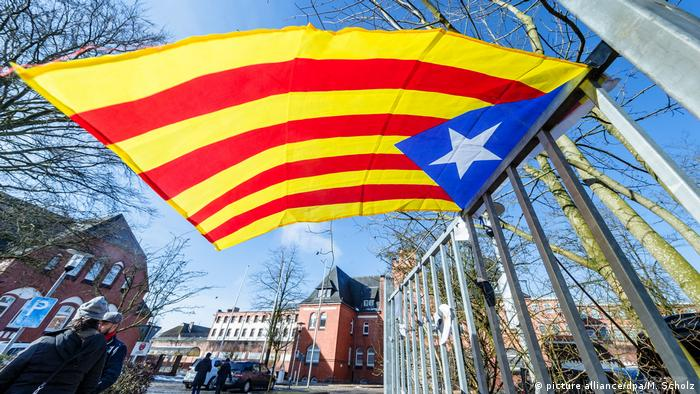 A Catalan estelada flag flies outside the prison where Puigdemont is being held