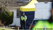 A police officer stands guard outside of the home of former Russian military intelligence officer Sergei Skripal, in Salisbury, Britain, March 8, 2018. Picture taken March 8, 2018. REUTERS/Peter Nicholls