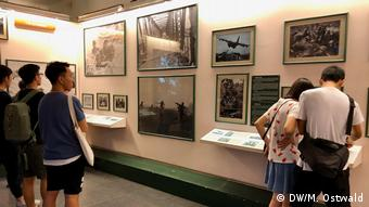 Visitors in front of the photos in the museum
