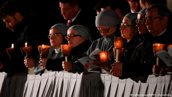 Nuns holding candles