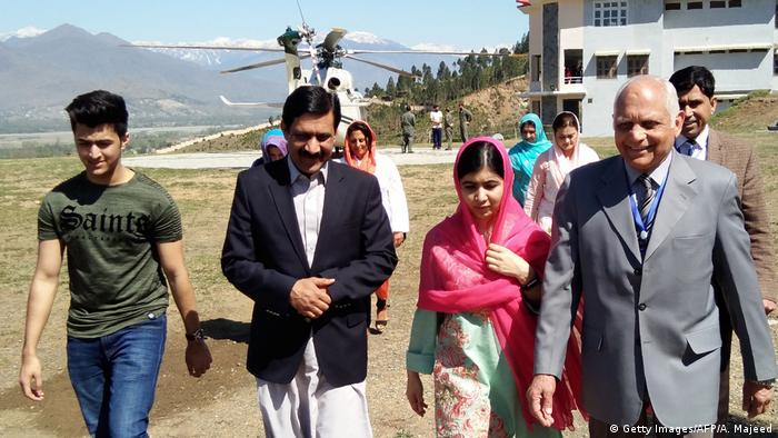 Malala Yousafzai arriving Mingora, in the background a helicopter
