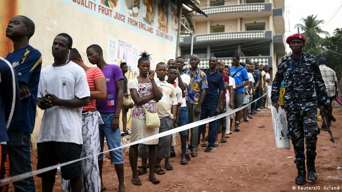 A long line of voters wait to cast their ballots in Sierra Leone.