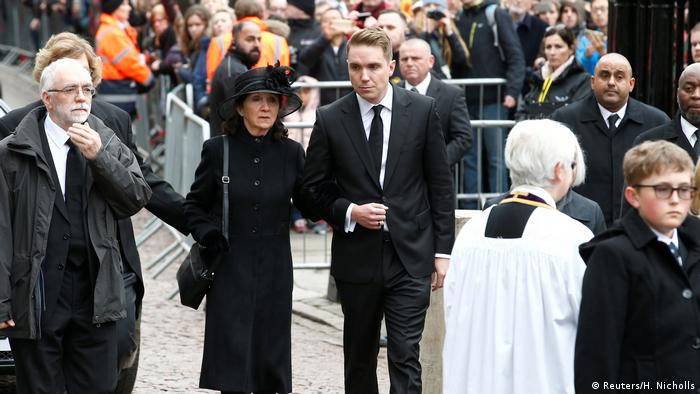Hawking's first wife, Jane, arrives at the funeral at Great St. Mary's Church in Cambridge, England with her son Timothy.