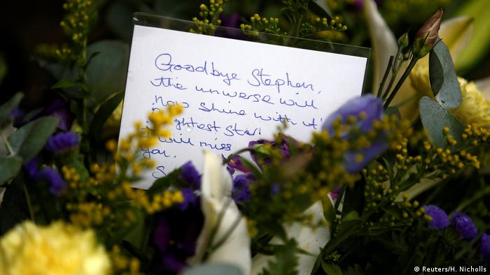 Among a floral tribute to Hawking is a hand written note thát begins, 'Goodbye Stephen.'