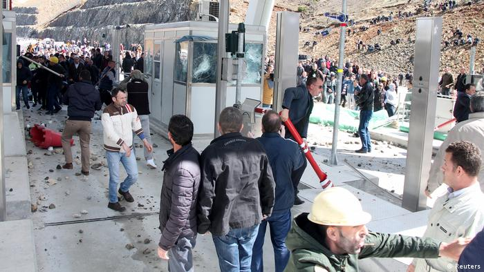 Protesters damage toll booths.