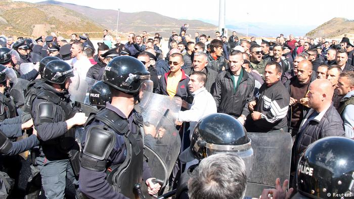 Protestors clash with police during a protest on the Durres-Kukes highway in Kalimash near Kukes, Albania.